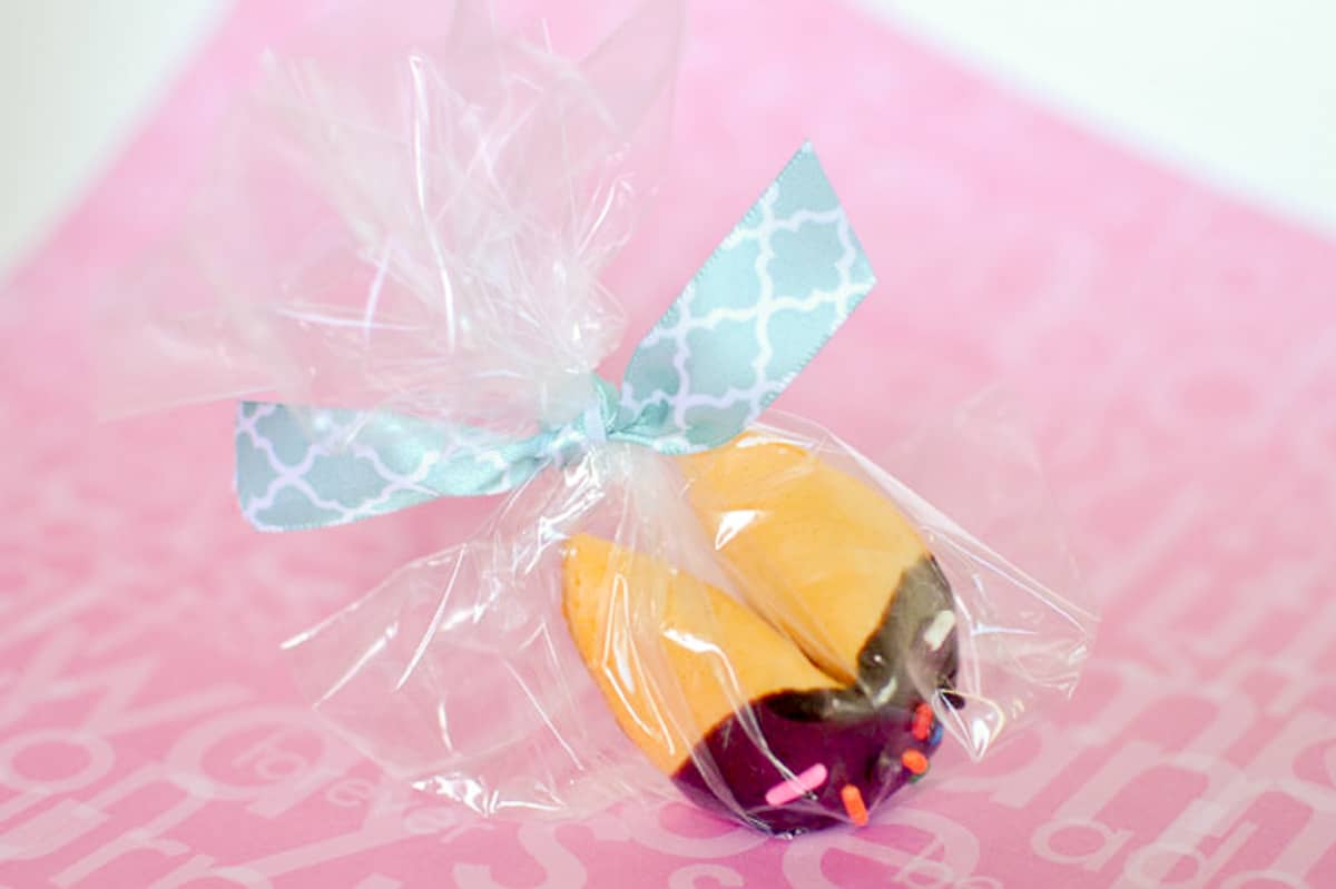 Chocolate Dipped Custom Fortune cookie gift idea - wrapped in a plastic bag & tied with blue ribbon