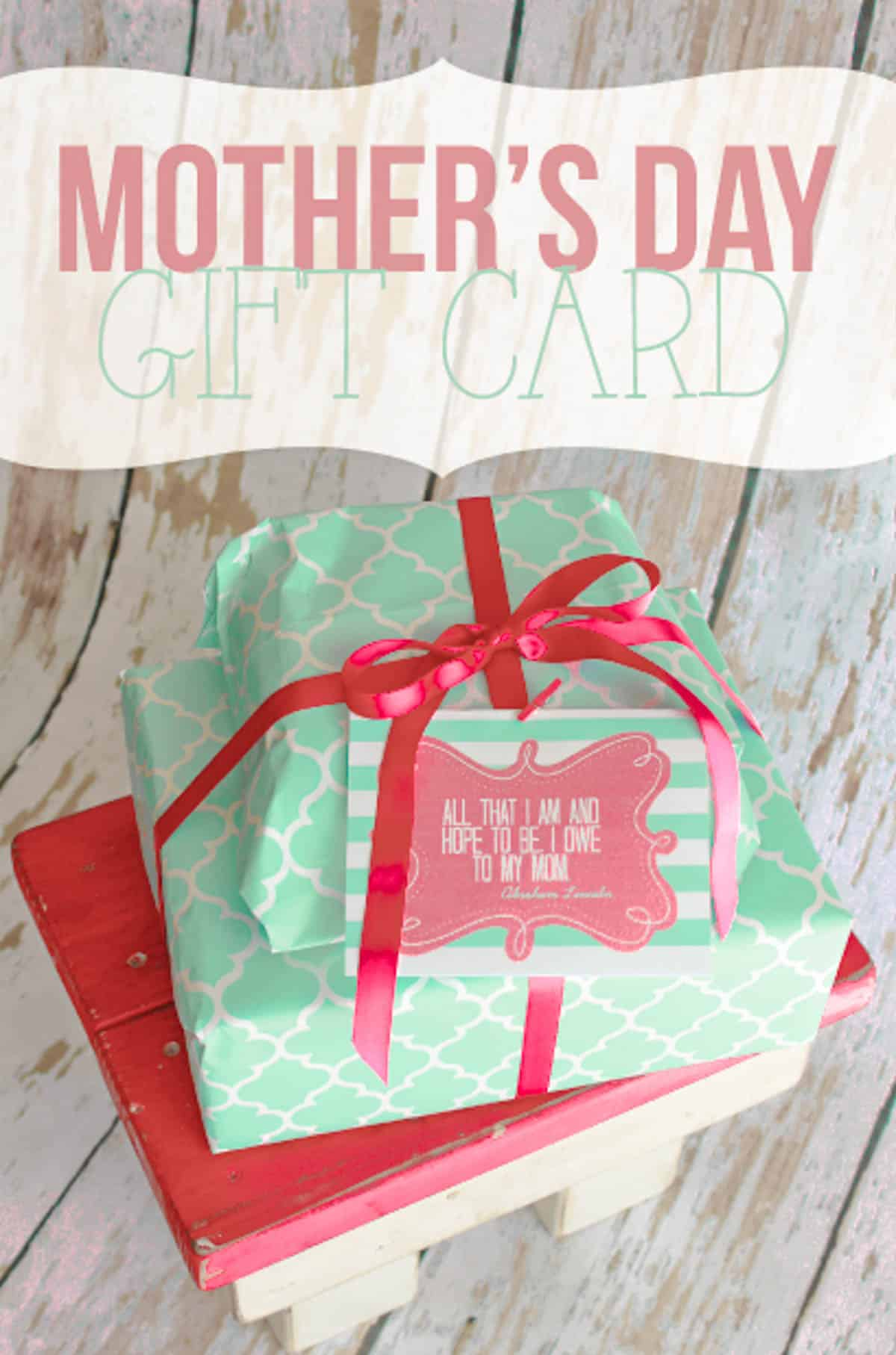 Free printable Mother's day card tag on top of two wrapped presents.