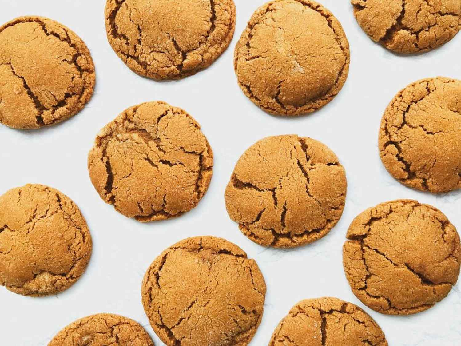 A white background with ginger molasses cookies on it.