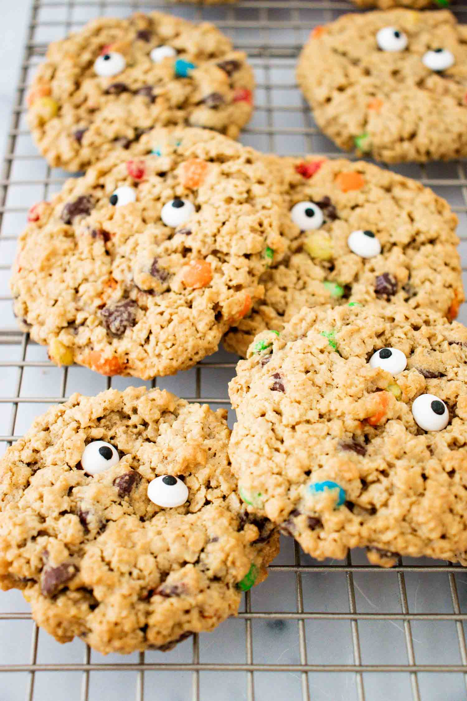 6 baked monster eye cookies on a wire rack