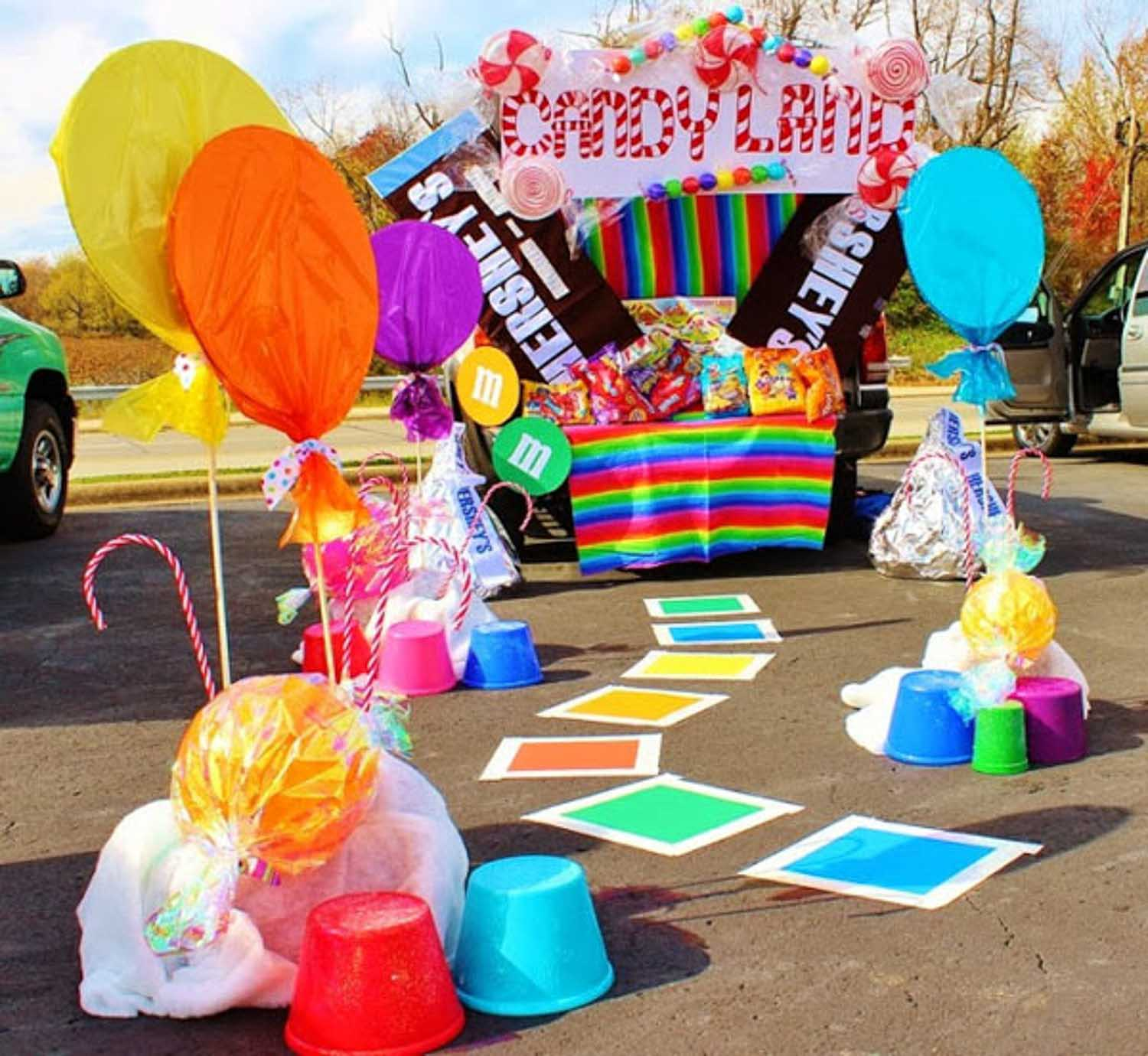 A candyland theme trunk or treat with big candies and balloons - great ideas for truck bed!
