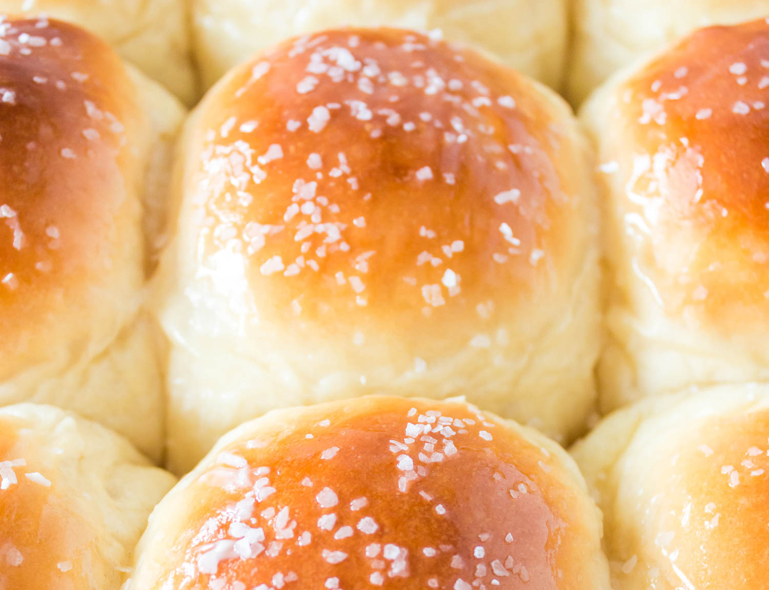 Rolls with butter and salt on them.