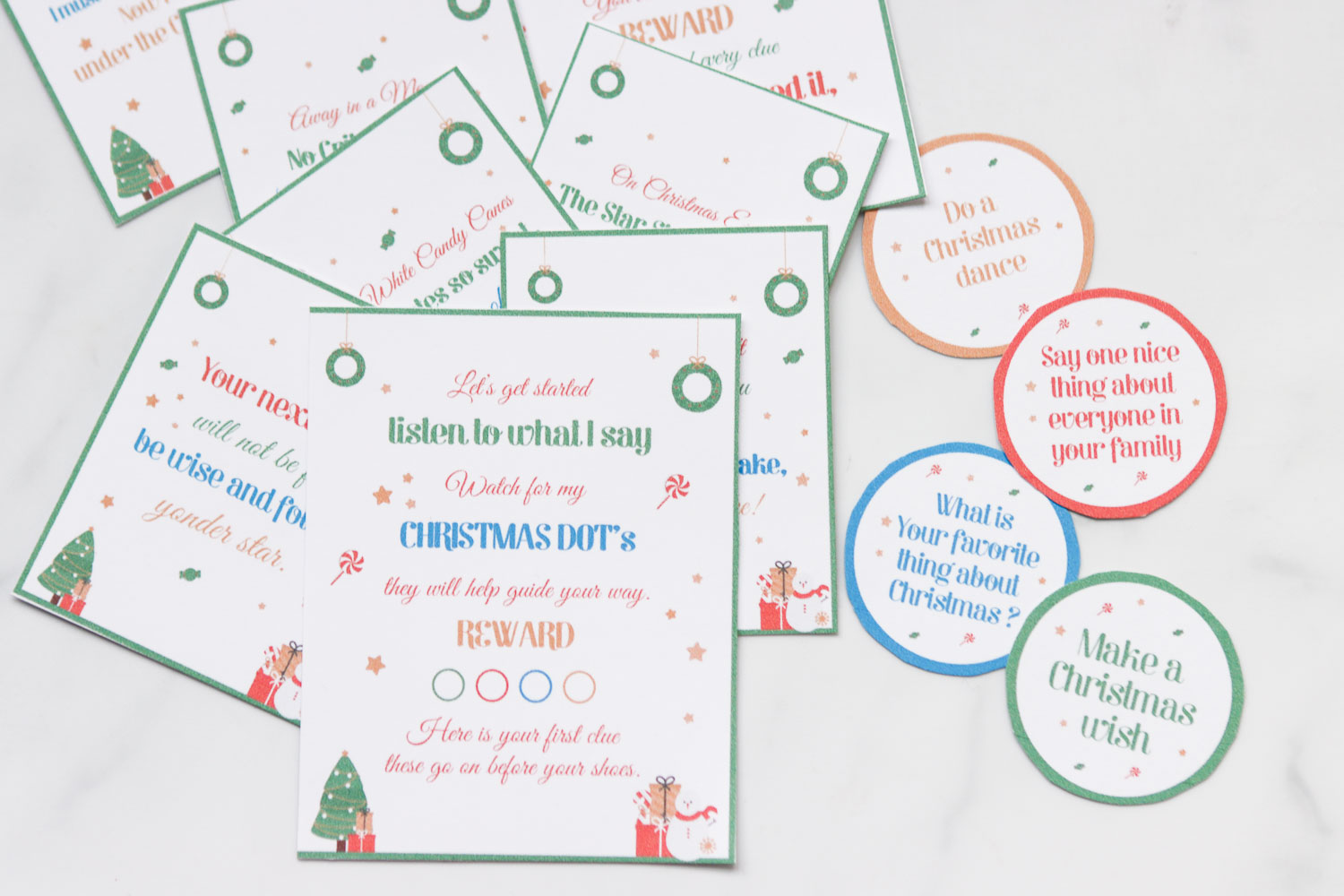 All the free printable clues cut out and on a white surface,