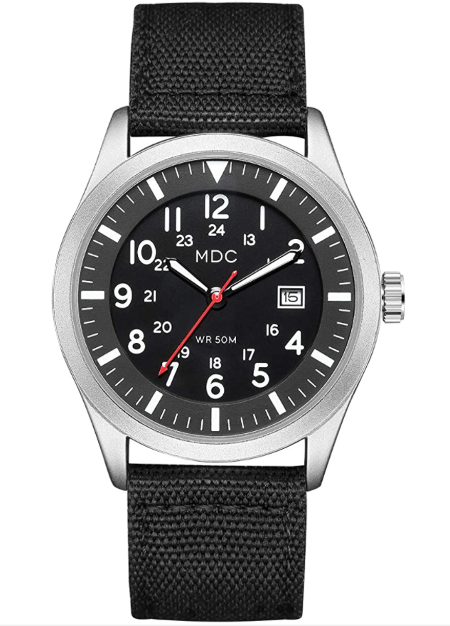 A black military analog watch with a silver outside and a black canvas band.